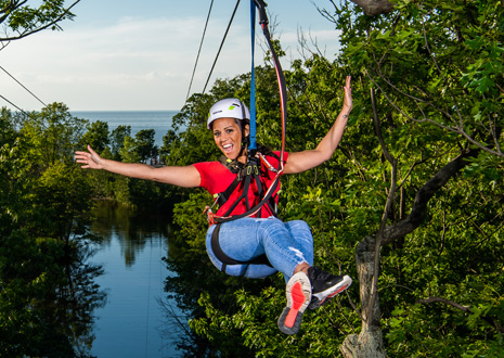 Girl in a red shirt on a zipline