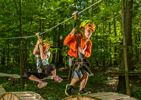Two kids on the Kids Adventure Course at Lake Erie Canopy Tours