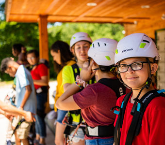 A group of kids in safety gear at Lake Erie Canopy Tours