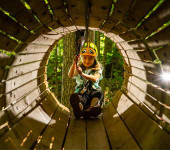 Girl in wooden tunnel