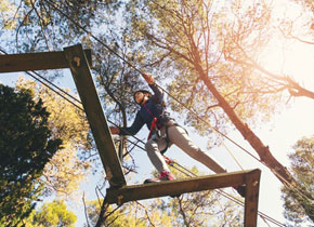 an adult shown from above walking through a challenge course